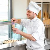 foto of confectioners  - Confectioner selling ice cream in the store - JPG