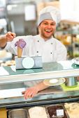 image of confectioners  - Confectioner selling ice cream in the pastry shop - JPG