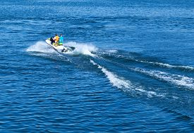 stock photo of waverunner  - mans on jet ski water sea  speed waverunner - JPG