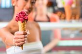pic of ice cream parlor  - Young female customer in an ice cream parlor with ice cream cornet - JPG