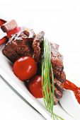 stock photo of red meat  - roast red beef meat fillet with red hot pepper with ketchup mayonnaise and mustard on plate isolated on white background - JPG