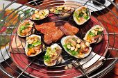 stock photo of pry  - Shell steaks on the grill in the restaurant - JPG