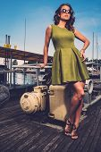 stock photo of old boat  - Stylish woman on old rusty boat  - JPG