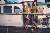image of old boat  - Stylish women on old rusty boat  - JPG