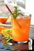 foto of vodka  - refreshing drink orange and mint with a little vodka - JPG