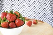 image of zigzag  - strawberry bowl on wooden table with zigzag background - JPG