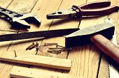 picture of pliers  - Hammer flat file pliers monkey wrench screws boards and blade on natural wooden background - JPG
