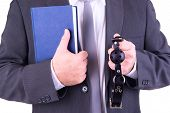 stock photo of gag  - Businessman holding ball gag and book - JPG