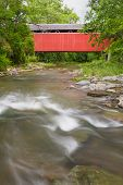 foto of covered bridge  - Built 1887 the red Stock-heughter Covered Bridge crosses Salt Creek in rural Franklin County Indiana. ** Note: Soft Focus at 100%, best at smaller sizes - JPG