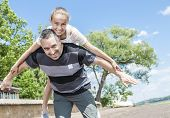 picture of time flies  - A Father and daughter having fun time outside - JPG