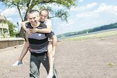 pic of time flies  - A Father and daughter having fun time outside - JPG