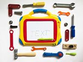stock photo of locksmith  - Background with toys locksmith tools Board letters top view - JPG