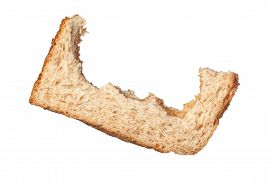 picture of fussy  - Bites taken off a slice of bread leaving only the crust isolated on white background - JPG