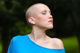 foto of chemotherapy  - Happy young cancer survivor after successful chemotherapy enjoying day in the nature - JPG