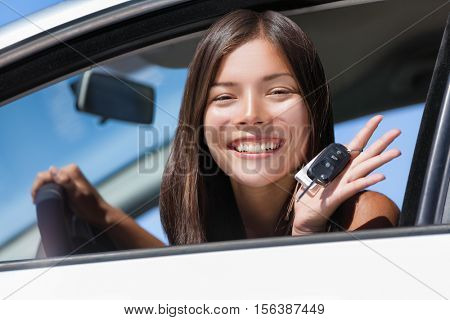 poster of Happy Asian girl teen driver showing new car keys. Young woman smiling driving new car holding key.