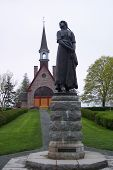 stock photo of acadian  - The Statue of Evangeline and the Church at Grand Pre - JPG