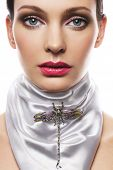 image of beautiful woman  - Beautiful woman with white silk scarf and brooch - JPG