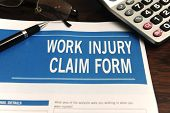 insurance: blank work injury claim form on desk (Form was created for this shooting - no property re