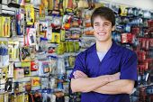 pic of cashiers  - portrait of the proud owner of a home improvement stores with tools in the background - JPG