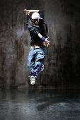 image of rap-girl  - modern style dancer posing on dirty grunge background - JPG