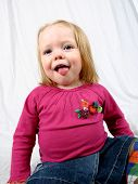 Cute Little Girl With Her Tongue Hanging Out. poster