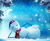 Merry Christmas and happy New Year greeting card with copy-space. Funny snowman   lying in the snow. poster