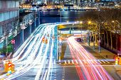 Light trails on the busy night streets, crossroad in big city, long exposure motion. New York City,  poster