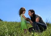 image of mother daughter  - Mother and daughter in a field - JPG