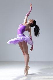 stock photo of ballet dancer  - modern style dancer posing on studio background - JPG
