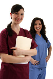 picture of medical assistant  - Two friendly and happy female medical workers - JPG