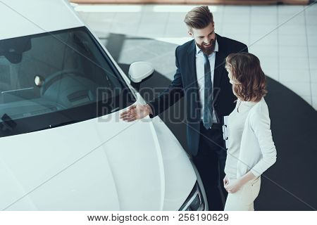 poster of Car Salesman Showing Car To Woman In Showroom. Car Buying Deal. Beautiful Young Woman Talking To Cau
