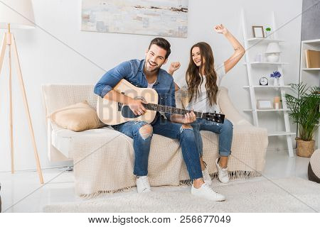 Smiling Man Playing On Acoustic