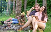 Find Companion To Travel And Hike. Friends Relaxing Near Campfire After Day Hiking Or Gathering Mush poster
