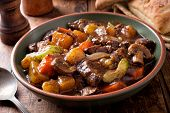 A Bowl Of Delcious Hearty Homemade Beef Stew With Potato, Turnip, Carrot, Celery, Mushroom And Onion poster