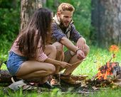 Roasting Marshmallows Popular Group Activity Around Bonfire. Couple Friends Prepare Roasted Marshmal poster