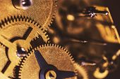 Details Of A Brassy Clockwork Mechanism, Cogwheels And Components poster