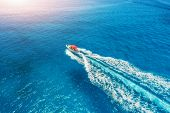 Motorboat At The Sea In Balearic Islands At Sunset. Aerial View Of Floating Speed Boat In Transparen poster