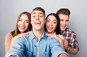 Four Attractive Nice Young Funky Smiling Friends, Two Girls And Two Guys Wearing Casual Taking Self  poster