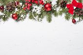 Christmas Background. Red Christmas Decorations With Snow And Fir Tree Branch On White Marble Table. poster
