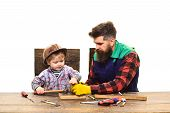 Mens Teamwork Concept. Father Teaching Little Son To Use Hammer. Father And Son In Workshop. Repair  poster