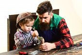 Son&father Repairing Together. Boy Connects Metal Plates Parts With Bolt&spanner. Daddy With Son In  poster