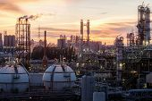 Gas Storage Sphere Tanks In Petrochemical Industry Or Oil And Gas Refinery Plant At Evening, Manufac poster