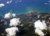 Aerial View Of Land And Blue Sea From Airplane Window. Thailand Landscape, Top View poster
