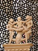 picture of kama  - Erotic sculptures from Khajuraho India depicting positions from the Kama Sutra set against colorful Indian backgrounds - JPG