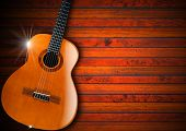 image of bluegrass  - Acoustic brown guitar against a rustic wood background - JPG