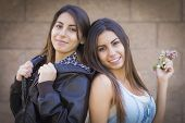 image of identical twin girls  - Two Beautiful Mixed Race Twin Sisters Portrait Outdoors - JPG