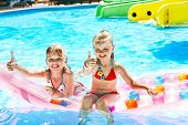 stock photo of inflatable slide  - Child on water slide at aquapark - JPG
