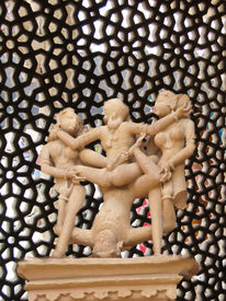 pic of kama  - Erotic sculptures from Khajuraho India depicting positions from the Kama Sutra set against colorful Indian backgrounds - JPG
