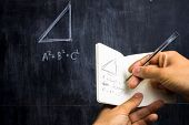 picture of pythagoras  - Man Taking Notes Of Math Theorem On Blackboard - JPG