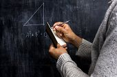 stock photo of pythagoras  - Man Taking Notes Of Math Theorem On Blackboard - JPG